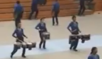 Indoor percussion playing drums